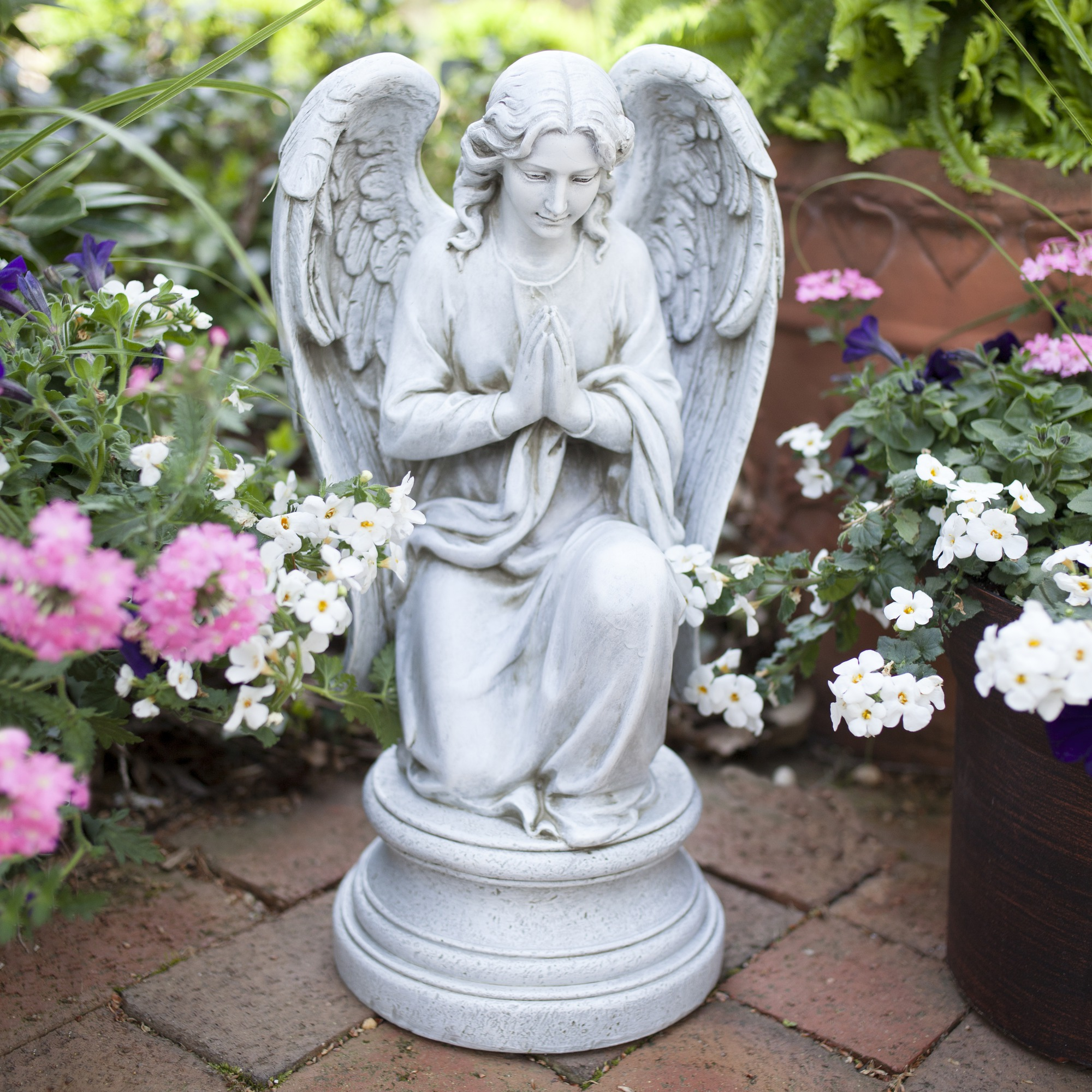 KneelingPraying Guardian Angel Outdoor Statue The Catholic Company