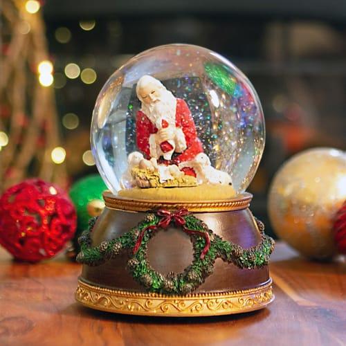 Kneeling Santa Musical Snow globe Glitterdome