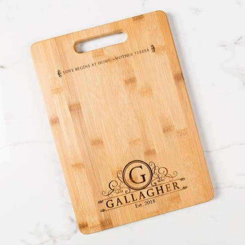 Love Begins at Home Cutting Board