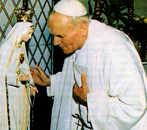 Pope St. John Paul II with an Our Lady of Fatima statue after the assasination attempt on his life.