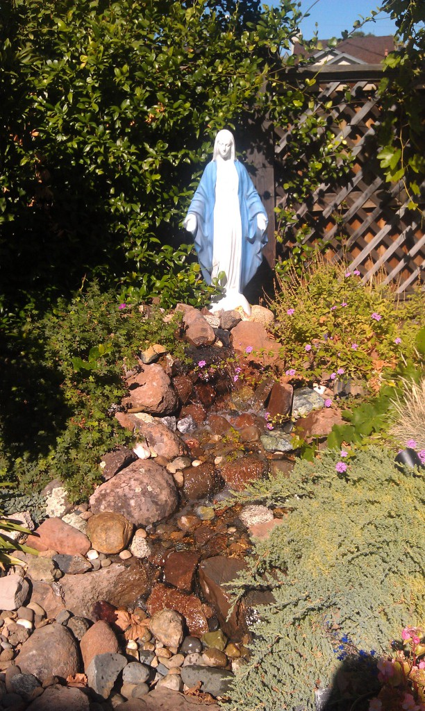 This photo from the garden of James and Patricia M. makes use of a water feature. Not only is water a lovely touch in a yard, but this stream from Our Lady's feet is reminiscent of a grotto spring.