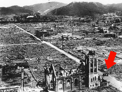 Hiroshima after the bombing - 4 Catholic missionary priests stand outside their church