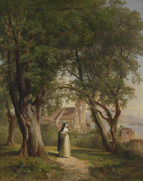 Nun walking along garden path while praying the Liturgy of the Hours