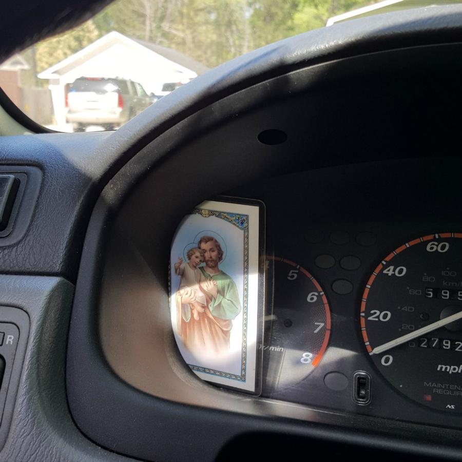 St. Joseph prayer card on the dashboard