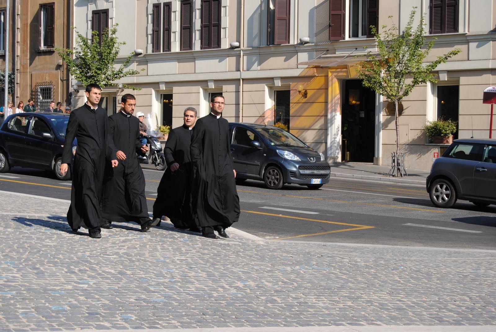 Priests Walking In Rome