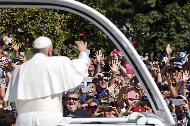 Look out those happy faces! Pope Francis waves to the crowd from the popemobile during a parade in Washington, Wednesday, Sept. 23, (AP Photo/Alex Brandon, Pool)