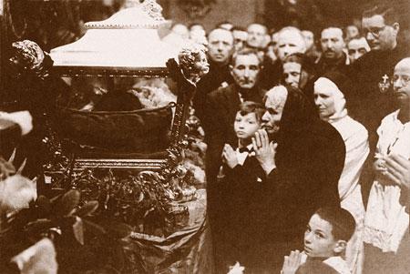 Assunta Goretti, the mother of St. Maria Goretti, prays at her daughter's canonization Mass in 1950.
