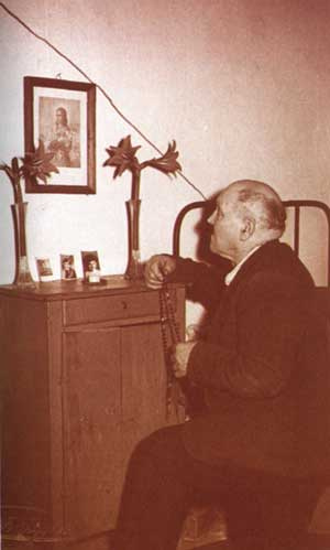 Alessandro Serenelli, now a reformed man, venerating an image of the girl who he killed - St. Maria Goretti