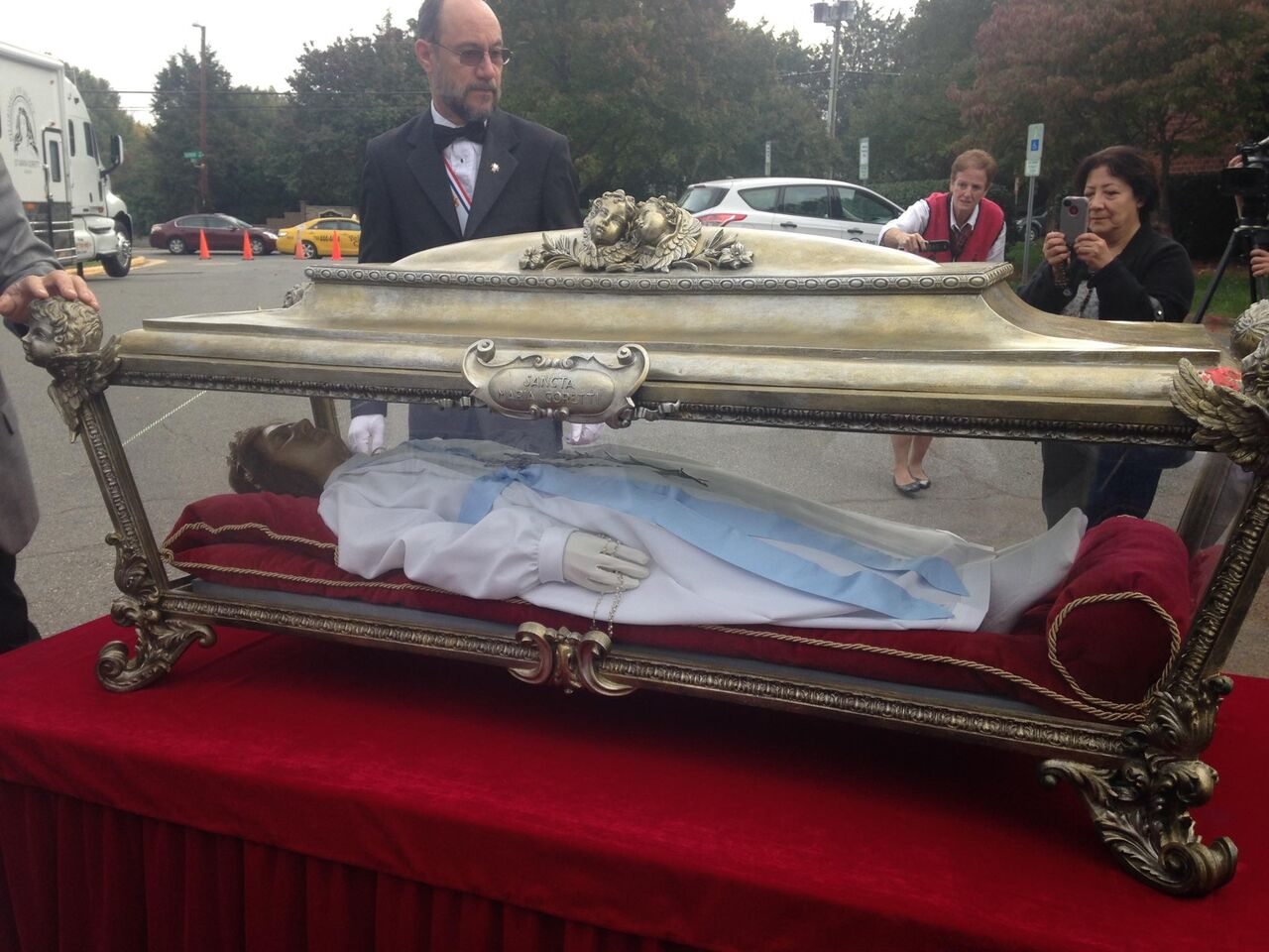 Taking St. Maria Goretti's casket off her tour bus in Charlotte