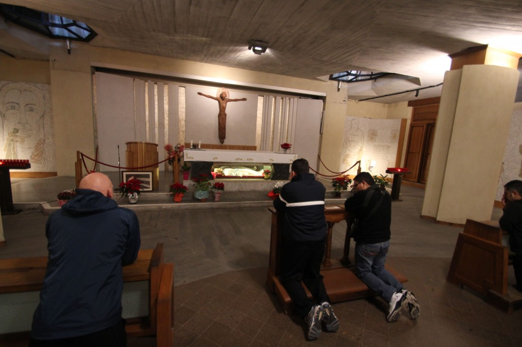 Pilgrims pray before the tomb of St. Maria Goretti in Italy (Photo: Oblates of the Virgin Mary)