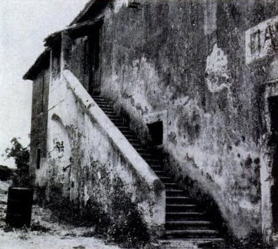The warehouse where the Goretti family lived. St. Maria was attacked in the kitchen at the top of these stairs.