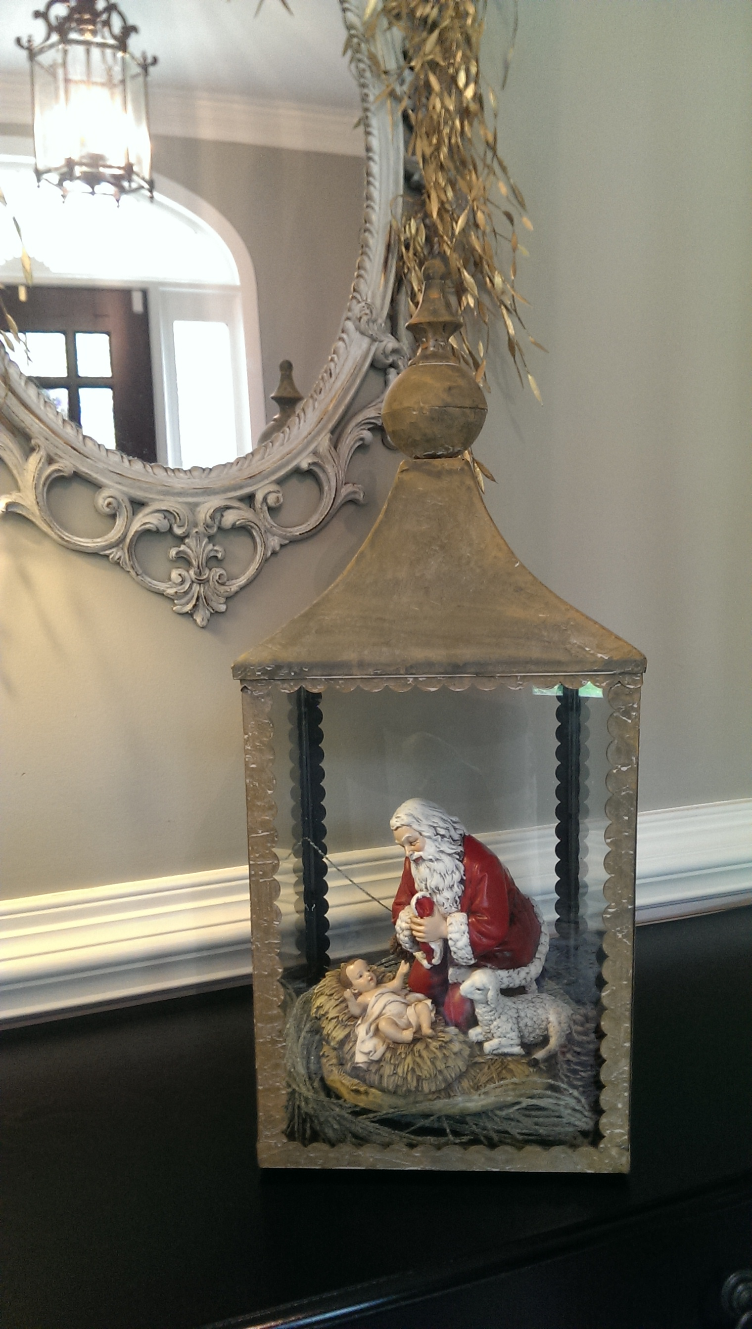 Kneeling Santa looks great as a display inside this Chapel Lantern