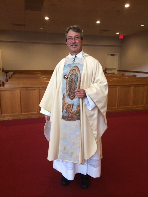 Fr. Mark Lawlor, pastor at St. Vincent de Paul, officiating a Quinceañera Mass.