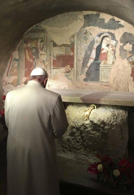 Pope Francis venerating the place of the original Nativity scene in Greccio begun by St. Francis of Assisi. Read the story at the link.
