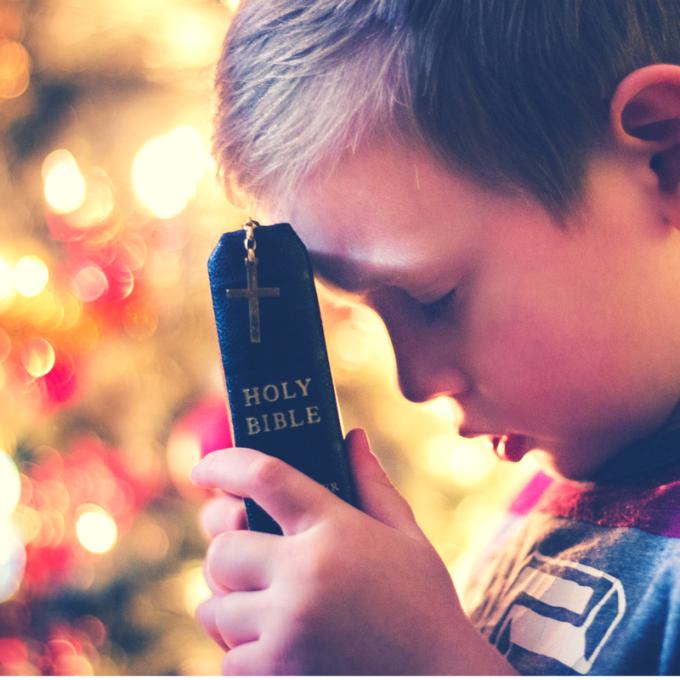 Child's praying at Christmas